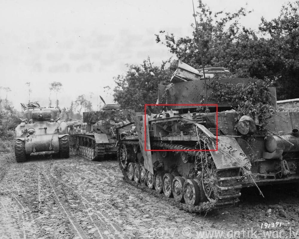 30_Infantry_Division_M4_Passes_2_German_Panzer_IV_Tanks_St_Lo_Normandy_1944.jpg